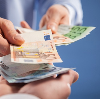 Businessman's  hands exchanging euro on blue background, closeup shot